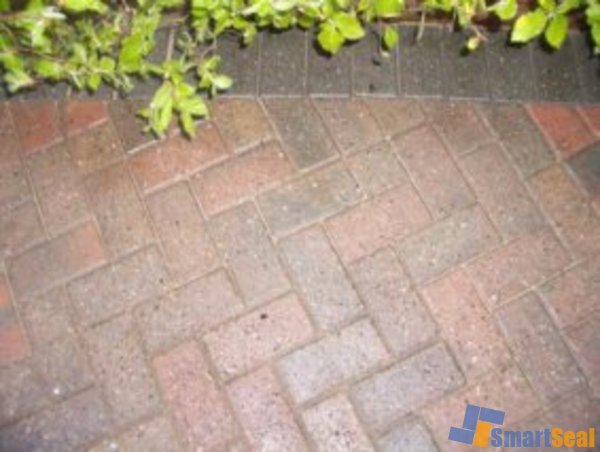 Block paving after cleaning and sealing